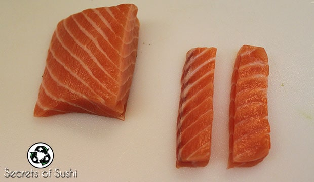 Salmon sliced for a salmon roll