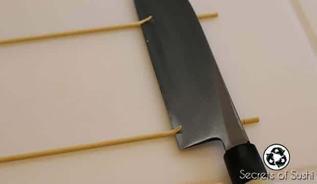 Katsuramuki chopsticks on a knife.