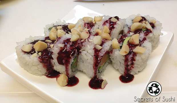 Adding sauce and toppings to Paleo Sushi